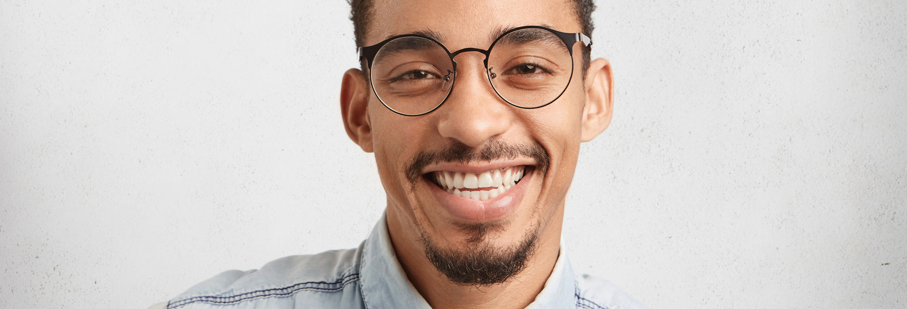 man with nice glasses smiling